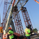 The team films an Iron Worker on a manlift high above Cornwall, Ontario.